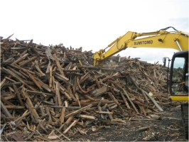 Photograph that it looks like we arrange wood which comes to pile up in temporary storage place
